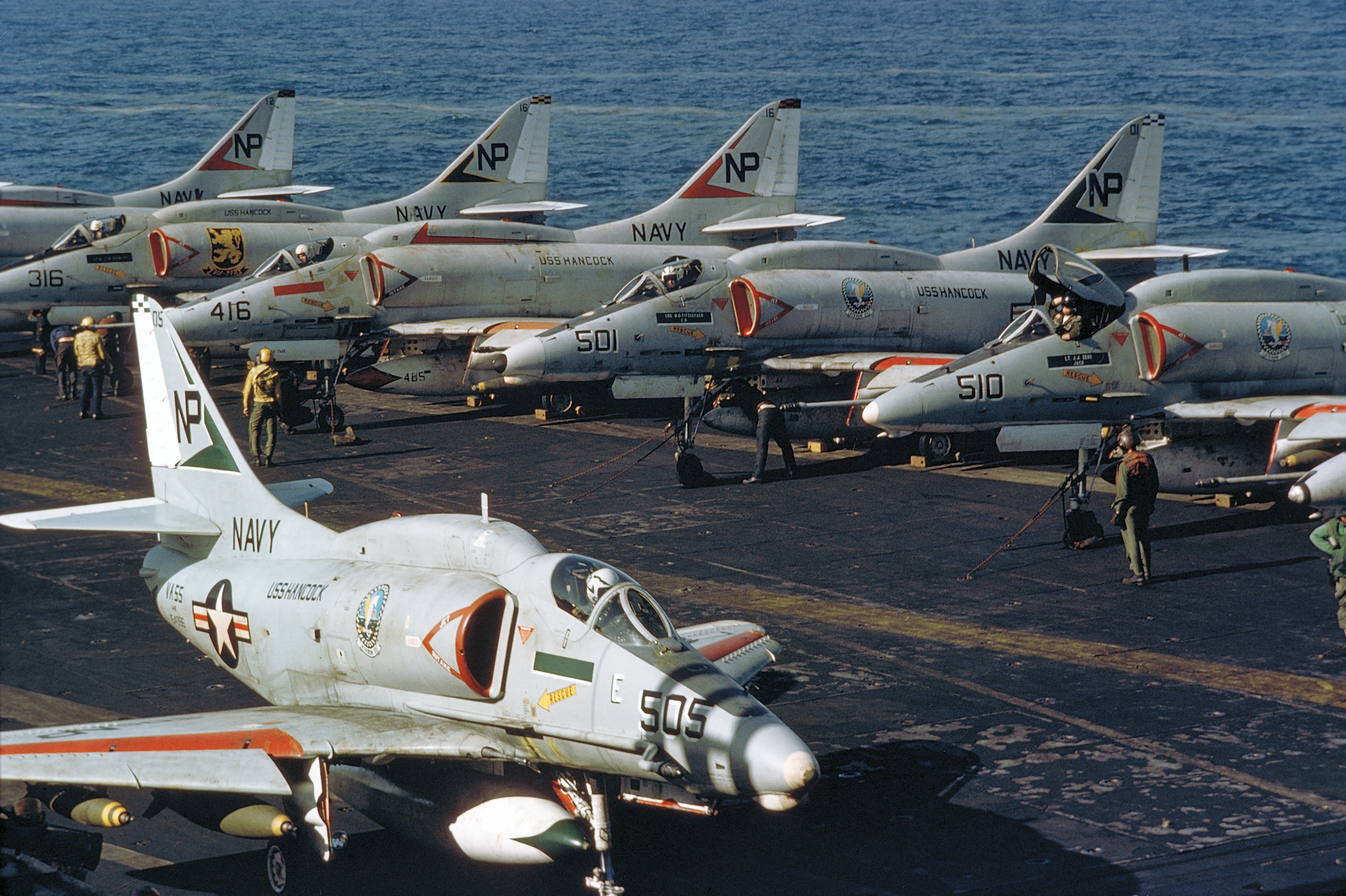 Attack Squadron 55 (VA-55) A-4F Skyhawk aircraft of Attack Carrier Wing 21 are parked on the flight deck of the attack aircraft carrier USS HANCOCK (CVA 19). Image via Wikipedia