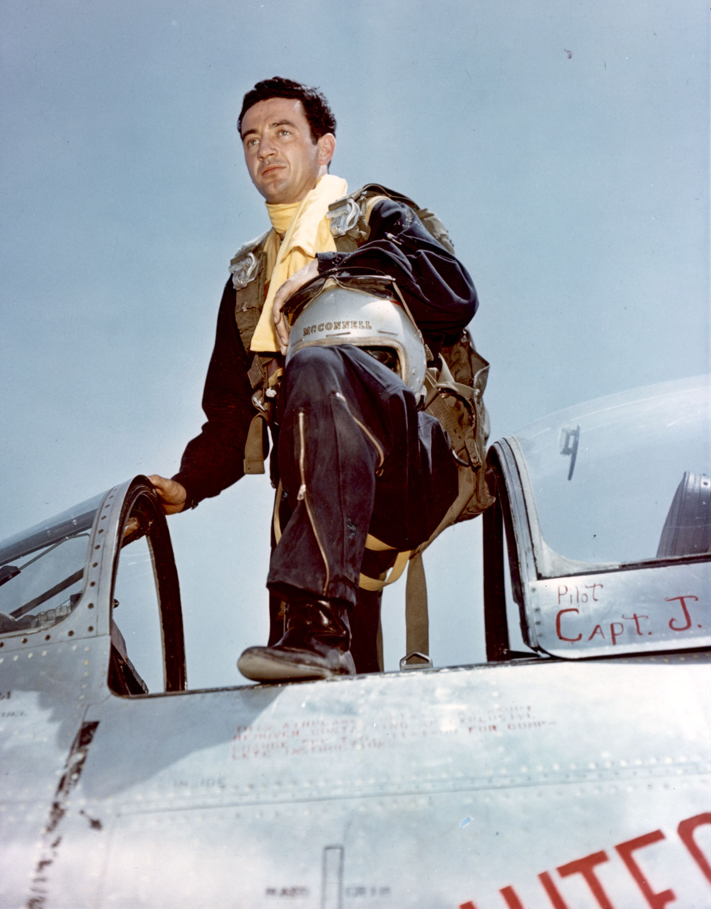 "#K6887 - Capt. Joseph McConnell, Jr., Mohawk Road, Apple Valley, Calif., pilot of the 51st Fighter Interceptor Wing, who became the 27th jet ace of the Korean Conflict on the 9th of March, 1953, is shown leaving the cockpit of his sleek F-86 ""Sabre"" jet. (U.S. Air Force Photo)"